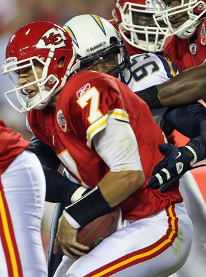 San Diego Chargers linebacker Shaun Phillips (#95) getting up close and personal with Kansas City Chiefs quarterback Matt Cassel (#7).