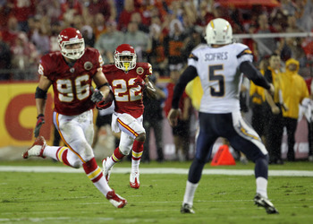 San Diego Chargers punter Mike Scifres attempts to stop Kansas City Chiefs punt returner Dexter McCluster (#22) from returning a punt for a touchdown.