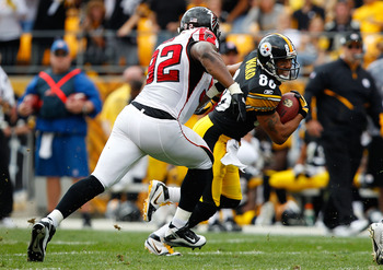 PITTSBURGH - SEPTEMBER 12: Hines Ward #86 of the Pittsburgh Steelers runs by Chauncey Davis #92 of the Atlanta Falcons after catching a pass during the NFL season opener game on September 12, 2010 at Heinz Field in Pittsburgh, Pennsylvania.  (Photo by Jar
