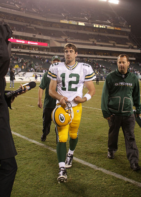 PHILADELPHIA - SEPTEMBER 12:  Aaron Rodgers #12 of the Green Bay Packers walks off the field after a win against the Philadelphia Eagles at Lincoln Financial Field on September 12, 2010 in Philadelphia, Pennsylvania.  (Photo by Mike Ehrmann/Getty Images)