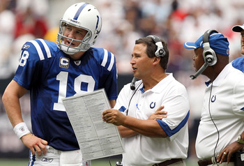 HOUSTON - SEPTEMBER 12:  Offensive coordinator Clyde Christensen talks with Peyton Manning #18 of the Indianapolis Colts at Reliant Stadium on September 12, 2010 in Houston, Texas.  (Photo by Ronald Martinez/Getty Images)