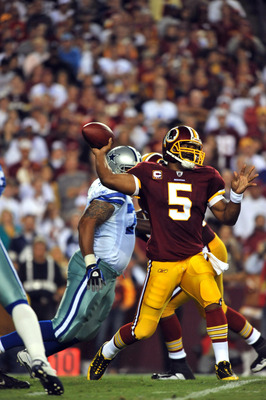 LANDOVER - SEPTEMBER 12:  Donovan McNabb #5 of the Washington Redskins passes during the NFL season opener against the Dallas Cowboys at FedExField on September 12, 2010 in Landover, Maryland.  (Photo by Larry French/Getty Images)