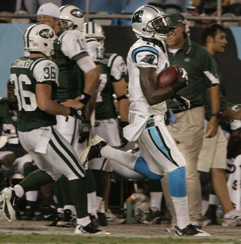 CHARLOTTE, NC - AUGUST 21:  Wade Receiver Brandon LaFell #11 of the Carolina Panthers runs out of bounds as Jim Leonhard #36 of the New York Jets peruses during their preseason game at Bank of America Stadium on August 21, 2010 in Charlotte, North Carolin