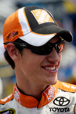 WATKINS GLEN, NY - AUGUST 08:  Joey Logano, driver of the #20 Home Depot Toyota, stands on the grid prior to the NASCAR Sprint Cup Series Heluva Good! Sour Cream Dips at Watkins Glen International on August 8, 2010 in Watkins Glen, New York.  (Photo by Ch