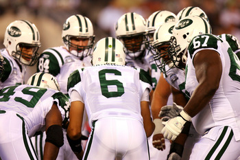 EAST RUTHERFORD, NJ - SEPTEMBER 13:  Mark Sanchez #6 of the New York Jets talks to his teammates in a huddle against the Baltimore Ravens during their home opener at the New Meadowlands Stadium on September 13, 2010 in East Rutherford, New Jersey.  (Photo
