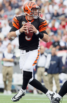 FOXBORO, MA - SEPTEMBER 12:  Carson Palmer #9 of the Cincinnati Bengals looks to pass against the New England Patriots during the NFL season opener on September 12, 2010 at Gillette Stadium in Foxboro, Massachusetts. The Patriots defeated the Bengals 38-2