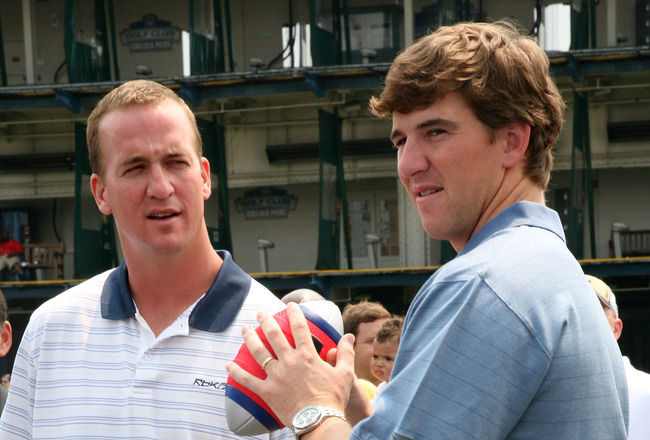 NEW YORK - JUNE 14:  (L-R) Indianapolis Colts quarterback Peyton Manning and New York Giants quarterback Eli Manning attends the NERF Father's Day Football Throwdown on June 14, 2008 at Chelsea Piers in New York City.  (Photo by Astrid Stawiarz/Getty Imag