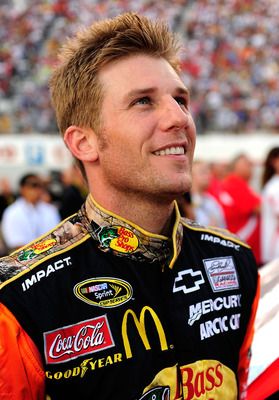 BRISTOL, TN - AUGUST 21:  Jamie McMurray, driver of the #1 Bass Pro Shops/Tracker Boats Chevrolet, looks on during the pre race show prior to the start of the NASCAR Sprint Cup Series IRWIN Tools Night Race at Bristol Motor Speedway on August 21, 2010 in