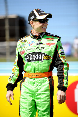 WATKINS GLEN, NY - AUGUST 07:  Mark Martin, driver of the #5 GoDaddy.com Chevrolet, stands on the grid during qualifying for the NASCAR Sprint Cup Series Heluva Good! Sour Cream Dips at Watkins Glen International on August 7, 2010 in Watkins Glen, New Yor