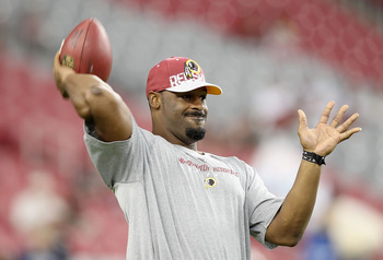 GLENDALE, AZ - SEPTEMBER 02:  Quarterback Donovan McNabb #5 of the Washington Redskins warms up before the preseason NFL game against the Arizona Cardinals at the University of Phoenix Stadium on September 2, 2010 in Glendale, Arizona. The Cardinals defea