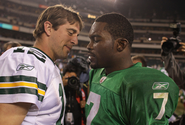 PHILADELPHIA - SEPTEMBER 12:  Michael Vick #7 of the Philadelphia Eagles  walks off the field and greets Aaron Rodgers #12 after a loss in a game against the Green Bay Packers at Lincoln Financial Field on September 12, 2010 in Philadelphia, Pennsylvania.