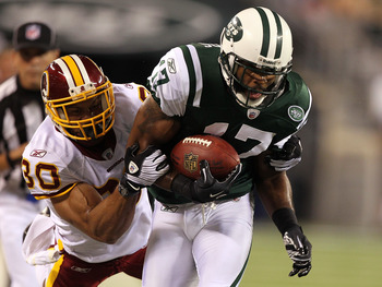 EAST RUTHERFORD, NJ - AUGUST 27:  Braylon Edwards #17 of the New York Jets is tackled by LaRon Landry #30 of the Washington Redskins  during their preseason game on August 27, 2010 at the New Meadowlands Stadium  in East Rutherford, New Jersey.  (Photo by