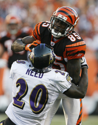 CINCINNATI - NOVEMBER 8: Chad Ochocinco #85 of the Cincinnati Bengals is tackled by Ed Reed #20 of the Baltimore Ravens at Paul Brown Stadium on November 8, 2009 in Cincinnati, Ohio.  (Photo by John Sommers II/Getty Images)