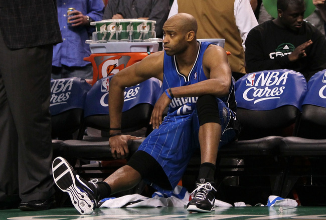 BOSTON - MAY 28:  Vince Carter #15 of the Orlando Magic looks on from the bench dejected after they lost 96-84 against the Boston Celtics in Game Six of the Eastern Conference Finals during the 2010 NBA Playoffs at TD Garden on May 28, 2010 in Boston, Mas