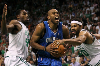 BOSTON - MAY 28:  Vince Carter #15 of the Orlando Magic drives against Tony Allen #42 (L) and Rasheed Wallace #30 of the Boston Celtics in Game Six of the Eastern Conference Finals during the 2010 NBA Playoffs at TD Garden on May 28, 2010 in Boston, Massa