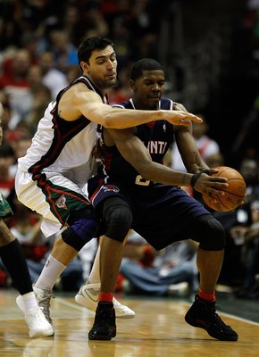 MILWAUKEE - APRIL 30: Joe Johnson #2 of the Atlanta Hawks is pressured by Carlos Delfino #10 of the Milwaukee Bucks in Game Six of the Eastern Conference Quarterfinals during the 2010 NBA Playoffs at the Bradley Center on April 30, 2010 in Milwaukee, Wisc