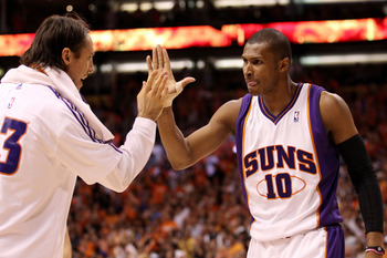 PHOENIX - MAY 25:  Steve Nash #13 of the Phoenix Suns congratulates teammate Leandro Barbosa #10 after a play against the Los Angeles Lakers in the fourth quarter of Game Four of the Western Conference Finals during the 2010 NBA Playoffs at US Airways Cen