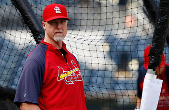 PITTSBURGH - AUGUST 25:  Hitting coach Mark McGwire #25 of the St. Louis Cardinals watches his team during batting practice before the game against the Pittsburgh Pirates on August 25, 2010 at PNC Park in Pittsburgh, Pennsylvania.  (Photo by Jared Wickerh
