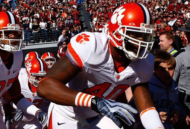 COLUMBIA, SC - NOVEMBER 28:  Andre Branch #40 and members of the Clemson Tigers run onto the field prior to the start of the game against the South Carolina Gamecocks at Williams-Brice Stadium on November 28, 2009 in Columbia, South  Carolina.  (Photo by
