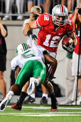 COLUMBUS, OH - SEPTEMBER 2: Dane Sanzenbacher #12 of the Ohio State Buckeyes runs with the ball against the Marshall Thundering Herd at Ohio Stadium on September 2, 2010 in Columbus, Ohio. (Photo by Jamie Sabau/Getty Images)