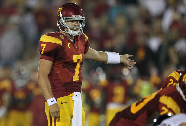 LOS ANGELES, CA - SEPTEMBER 11:  Quarterback Matt Barkley #7 of the USC Trojans calls signals against the Virginia Cavaliers at Los Angeles Memorial Coliseum on September 11, 2010 in Los Angeles, California. USC won 17-14.  (Photo by Stephen Dunn/Getty Im