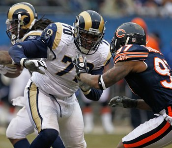 CHICAGO - DECEMBER 06: Alex Barron #70 of the St. Louis Rams movesto block Mark Anderson #97 of the Chicago Bears at Soldier Field on December 6, 2009 in Chicago, Illinois. The Bears defeated the Rams 17-9. (Photo by Jonathan Daniel/Getty Images)