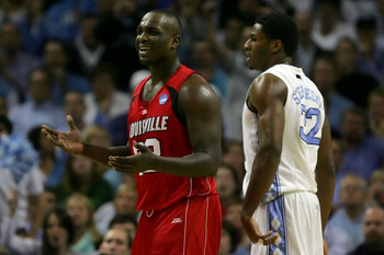 CHARLOTTE, NC - MARCH 29:  Derrick Caracter #32 of the Louisville Cardinals reacts as he stands alongside Alex Stepheson #32 of the North Carolina Tar Heels during the 2008 NCAA Men's East Regional Final at Bobcats Arena on March 29, 2008 in Charlotte, No