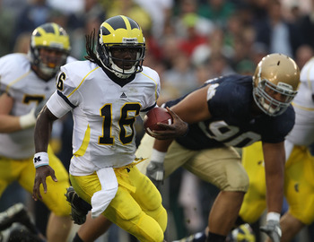 SOUTH BEND, IN - SEPTEMBER 11: Denard Robinson #16 of the Michigan Wolverines runs past Ethan Johnson #90 of the Notre Dame Fighting Irish at Notre Dame Stadium on September 11, 2010 in South Bend, Indiana. Michigan defeated Notre Dame 28-24.  (Photo by J