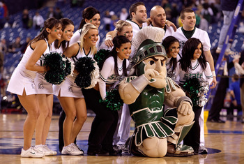 INDIANAPOLIS - MARCH 27:  Sparty the mascot of the Michigan State Spartans poses for a photo with the cheerleaders against the Kansas Jayhawks during the third round of the NCAA Division I Men's Basketball Tournament at the Lucas Oil Stadium on March 27,