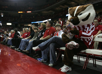 MADISON, WI - JANUARY 05: Bucky, the mascot of the Wisconsin Badgers, pretends to read a program while sitting courtside before a game between Wisconsin and the Iowa Hawkeyes on January 5, 2008 at the Kohl Center in Madison, Wisconsin. Wisconsin defeated