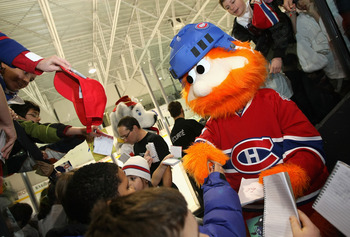 MONTREAL - JANUARY 25:  Montreal Canadiens mascot, Youppi signs autographs for fans during the NHL All Star Mascot Breakfast at the Bell Centre Sports Complex on January 25, 2009 in Montreal, Canada.  (Photo by Nick Laham/Getty Images)