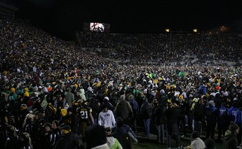IOWA CITY, IOWA - NOVEMBER 8: Iowa Hawkeyes fans rush the field and celebrate as their team upset the Penn State Nittany Lions by kicking a field goal with six seconds left on the clock at Kinnick Stadium on November 8, 2008 in Iowa City, Iowa. Iowa defea