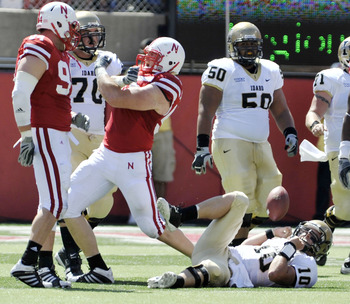 LINCOLN, NEBRASKA - SEPTEMBER 11: Idaho Vandals quarterback Nathan Enderle #10 looks up from the turf as Nebraska Cornhuskers defensive tackle Baker Steinkuhler #55 and Nebraska Cornhuskers defensive tackle Jared Crick celebrate a sack during first half a
