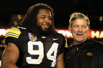 MIAMI GARDENS, FL - JANUARY 05:  Andrian Clayborn #94 and head coach Kirk Ferentz of the Iowa Hawkeyes celebrate after Iowa won 24-14 against the Georgia Tech Yellow Jackets during the FedEx Orange Bowl at Land Shark Stadium on January 5, 2010 in Miami Ga