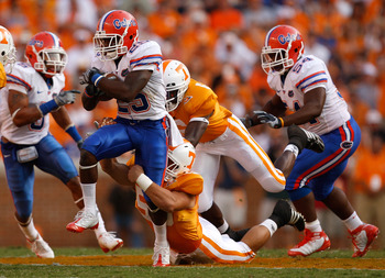 KNOXVILLE, TN - SEPTEMBER 20:  Brandon James #25 of the Florida Gators is tackled from behind by Nick Reveiz #56 of the Tennessee Volunteers during their game at Neyland Stadium on September 20, 2008 in Knoxville, Tennessee.  (Photo by Streeter Lecka/Gett