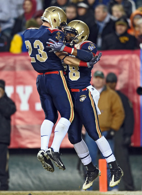 PHILADELPHIA - DECEMBER 12: Running back Marcus Curry #28 and running back Cory Finnerty # 23 of the Navy Midshipmen celebrate Curry's touchdown reception during the game against the Army Black Knights on December 12, 2009 at Lincoln Financial Field in Ph