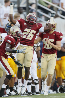CHESTNUT HILL, MA - SEPTEMBER 11:  Dominick LeGrande #26 of the Boston College Eagles celebrates with teammates Jim Noel #23 and Ryan Quigley #46 after LeGrande recovered a fumble in the second half  the Kent State Golden Flashes on September 11, 2010 at