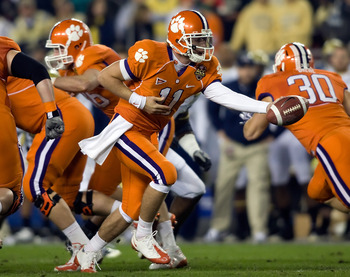 TAMPA - DECEMBER 05:  Quarterback Kyle Parker #11 of the Clemson Tigers hands the ball off against the Georgia Tech Yellow Jackets in the 2009 ACC Football Championship game at Raymond James Stadium on December 5, 2009 in Tampa, Florida.  (Photo by J. Mer