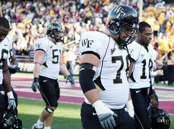 CHESTNUT HILL, MA - SEPTEMBER 26:  Joe Birdsong #76, John Russell #51 and Danny Dembry #18 of the Wake Forest Demon Deacons walk off the field after the loss to the Boston College Eagles on September 26, 2009 at Alumni Stadium in Chestnut Hill, Massachuse