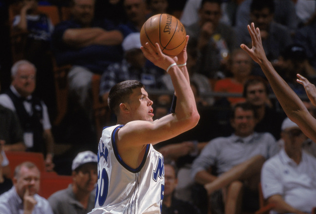 29 Nov 2001:  Orlando Magic forward Mike Miller #50 shoots the ball during the NBA game against the Boston Celtics at the TD Waterhouse in Orlando, Florida.  The Celtics crushed the Magic 99-89.Mandatory Credit:  Andy Lyons/Getty Images