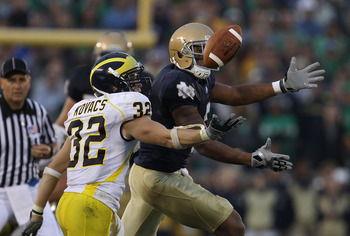 SOUTH BEND, IN - SEPTEMBER 11: Jordan Kovacs #32 of the Michigan Wolverines breaks up a pass intended for Michael Floyd #3 of the Notre Dame Fighting Irish at Notre Dame Stadium on September 11, 2010 in South Bend, Indiana. Michigan defeated Notre Dame 28
