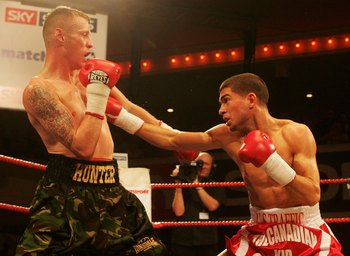 HARTLEPOOL, ENGLAND - NOVEMBER 10: Steve Molitor of Canada lands a punch on Michael Hunter of Great Britain during the IBF Super Bantamweight Crown at Borough Hall on November 10, 2006 in Hartlepool, England. (Photo by Matthew Lewis/Getty Images)