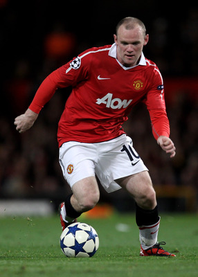 MANCHESTER, ENGLAND - SEPTEMBER 14:  Wayne Rooney of Manchester United in action during the UEFA Champions League Group C match between Manchester United and Rangers at Old Trafford on September 14, 2010 in Manchester, England.  (Photo by Alex Livesey/Get