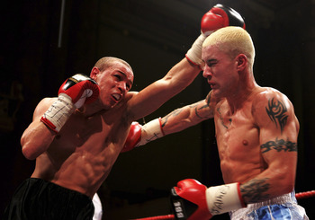 LEEDS, UNITED KINGDOM - FEBRUARY 09:  Carl Johanneson (l) punches Ricky Burns  during the British Super Featherweight title fight between Carl Johanneson and Ricky Burns at Leeds Town Hall on February 9, 2007 in Leeds, England.  (Photo by Bryn Lennon/Gett