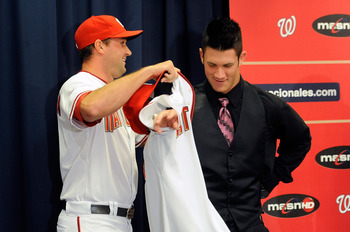 WASHINGTON - AUGUST 26:  Ryan Zimmerman #11 of the Washington Nationals presents Bryce Harper #34 with his jersey during a press conference at Nationals Park on August 26, 2010 in Washington, DC.  (Photo by Greg Fiume/Getty Images)