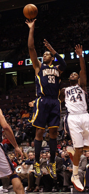 EAST RUTHERFORD, NJ - JANUARY 15:  Danny Granger #33 of the Indiana Pacers shoots against Trenton Hassell #44 of the New Jersey Nets at the Izod Center on January 15, 2010 in East Rutherford, New Jersey. NOTE TO USER: User expressly acknowledges and agree