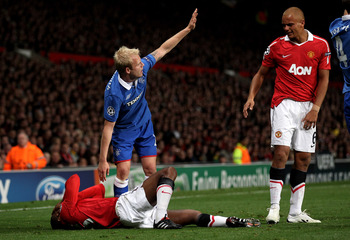 MANCHESTER, ENGLAND - SEPTEMBER 14:  Steven Naismith of Rangers checks on the injured Antonio Valencia of Manchester United during the UEFA Champions League Group C match between Manchester United and Rangers at Old Trafford on September 14, 2010 in Manch