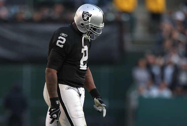 OAKLAND, CA - JANUARY 03:  JaMarcus Russell #2 of the Oakland Raiders walks off the field against the Baltimore Ravens during an NFL game at Oakland-Alameda County Coliseum on January 3, 2010 in Oakland, California.  (Photo by Jed Jacobsohn/Getty Images)