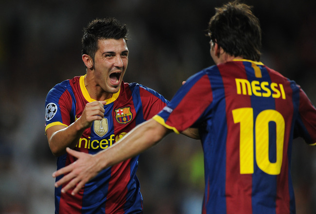 BARCELONA, SPAIN - SEPTEMBER 14:  David Villa (L) of Barcelona celebrates scoring his sides second goal with his teammate Lionel Messi during the UEFA Champions League group D match between Barcelona and Panathinaikos on September 14, 2010 in Barcelona, S