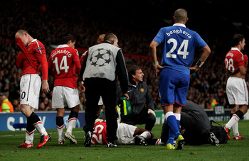 Antonio Valencia of Manchester United receives treatment for an injury during the UEFA Champions League Group C match between Manchester United and Rangers at Old Trafford on September 14, 2010 in Manchester, England.